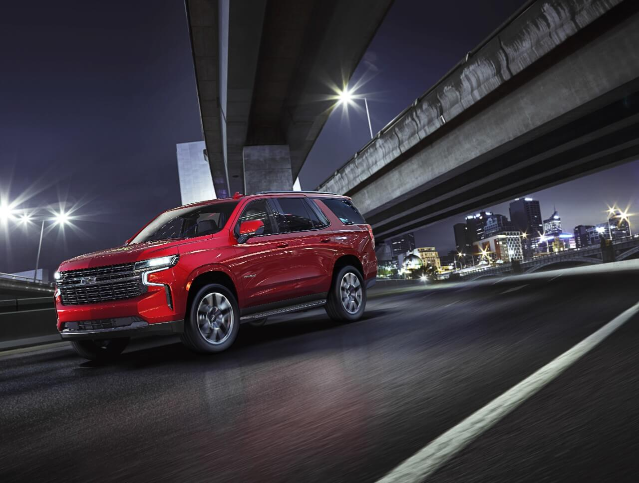red Chevrolet Tahoe at night